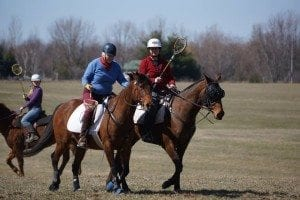 Kristy in action playing Polocrosse!